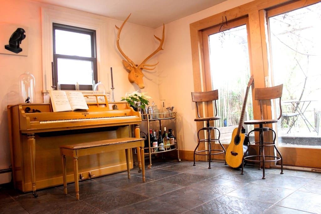 Music room, in the kitchen with a garden view.
