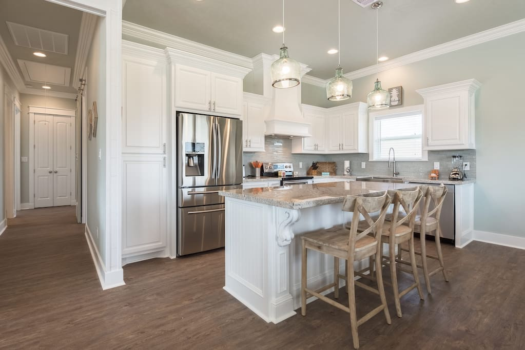 Step in to Paradise! This house hosts a large open floor plan with a kitchen with an eat up bar that opens to both the dining and living room.