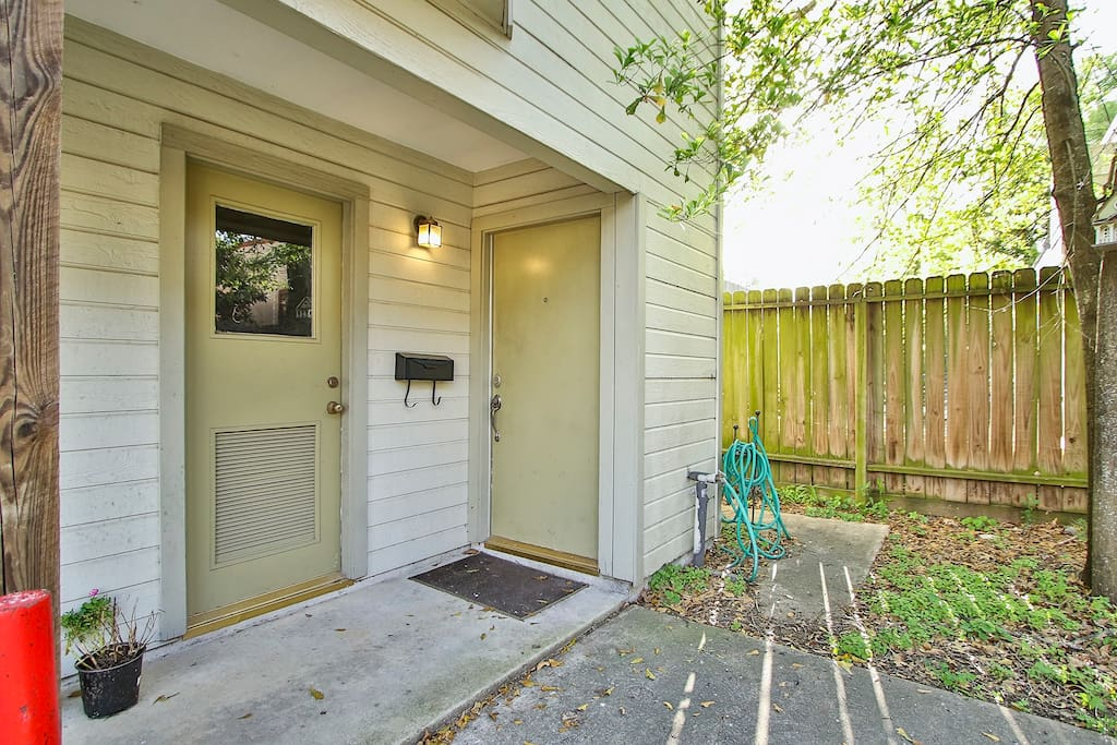 Front Entrance.  Left door is to the utility room with washer/dryer.  Right door is entry.