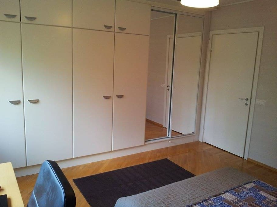 Master bedroom with ample storage space