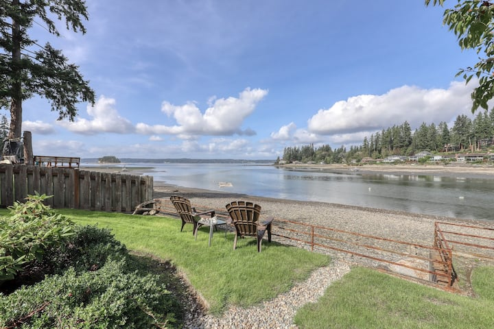 Waterfront home & on-site guest house w/ full kitchens, a large deck, & firepits