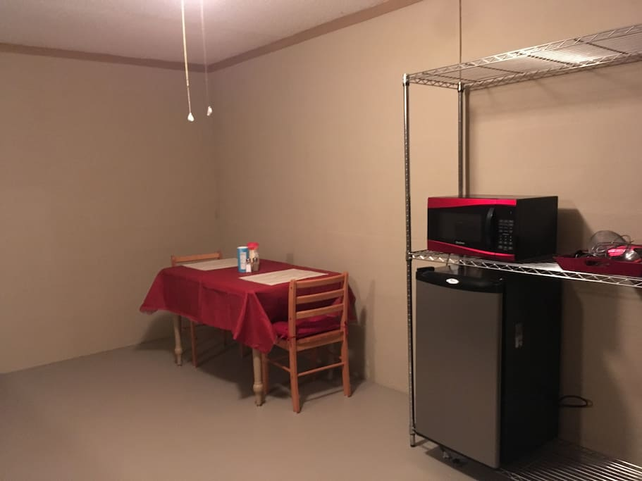 Small table and chairs Microwave and Refrigerator