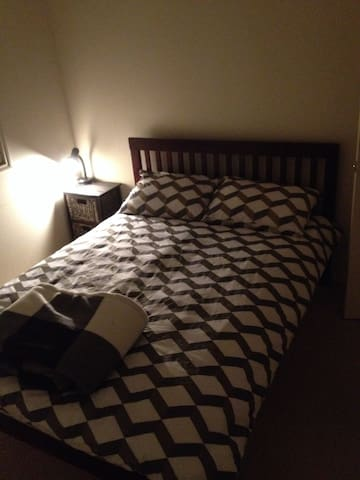 clean tidy room with double bed and built inns