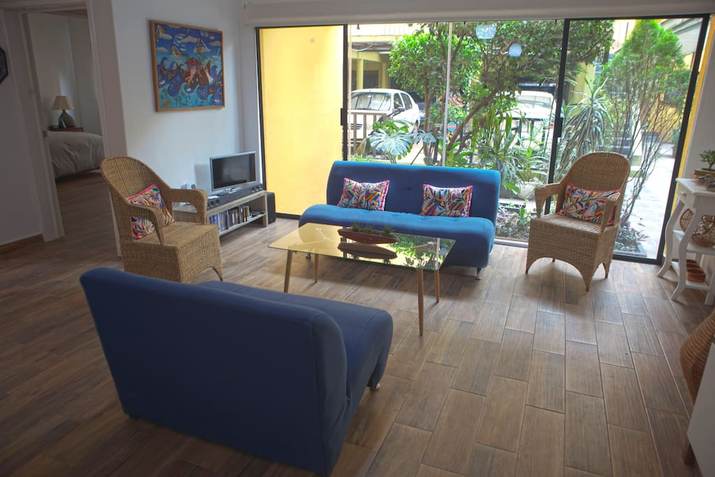 Living room overlooking garden. High-speed internet, Apple TV, complimentary movies for adults and children.
