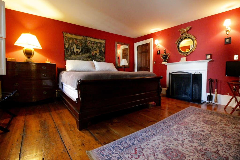 Master bedroom with comfortable king bed and fireplace for romantic evenings.