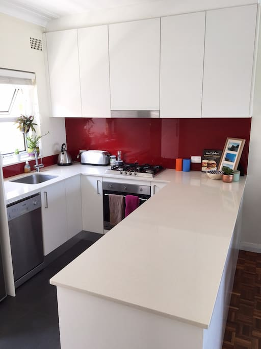 Contemporary kitchen with lots of space for cooking & chatting to guests