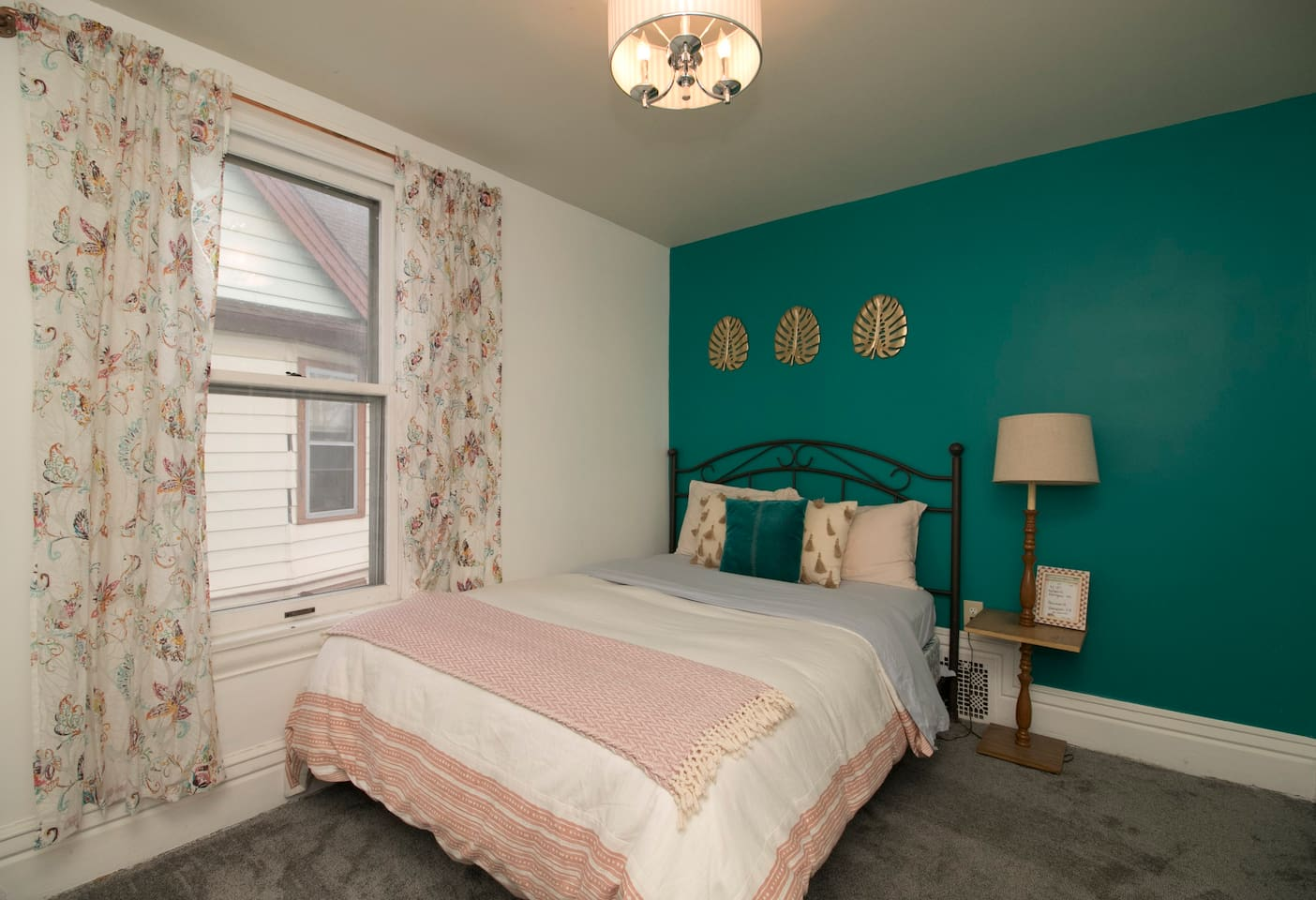 Your private bedroom- complete with linens and towels for your needs and a window AC unit. Brand new carpet. You are located on the 2nd floor of the house. There are 3 other bedrooms as well as the full bathroom on this floor
