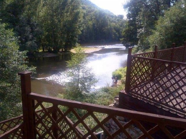 River weir cottage with spectacular mountain views