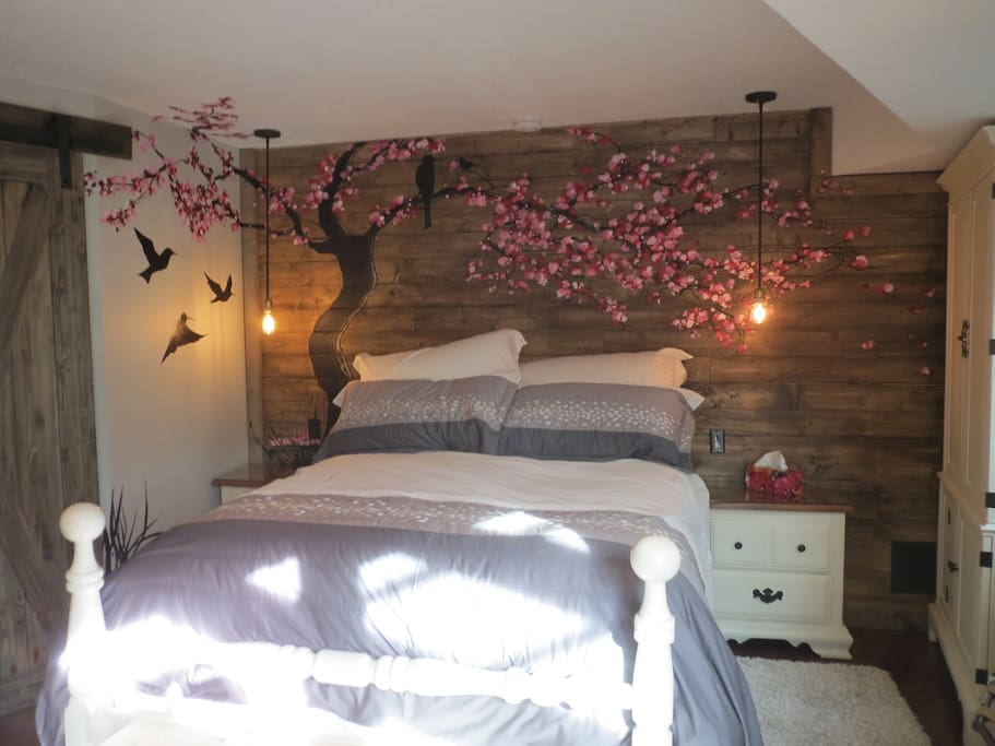 A beautiful hand painted cherry tree mural framing your own queen bed.