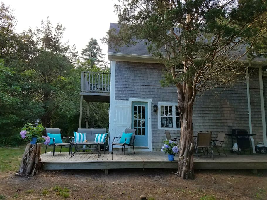 Deck and balcony. Lots of seating, dining table, gas grill