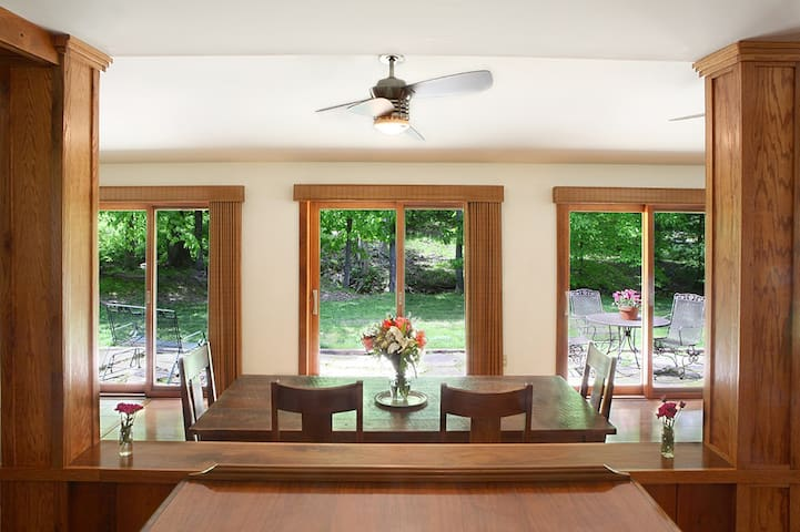 The dining area is adjacent to the living room, large galley-style kitchen and the creekside patio.