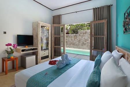 Cozy Deluxe Room with Pool View - Kubu