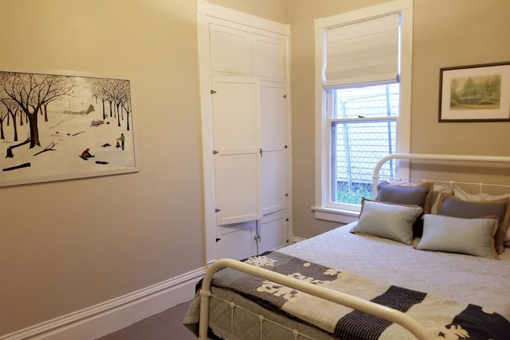 Second Bedroom features Queen size bed with memory foam mattress, original built in armoire - and has its own air conditioner as well as ceiling fan.