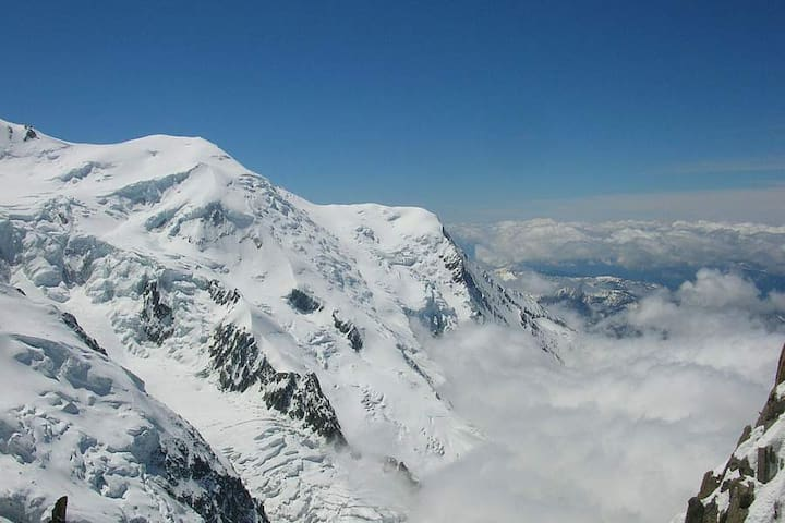 The mountain tops of the  pure white Alps are just a Ski Lift away