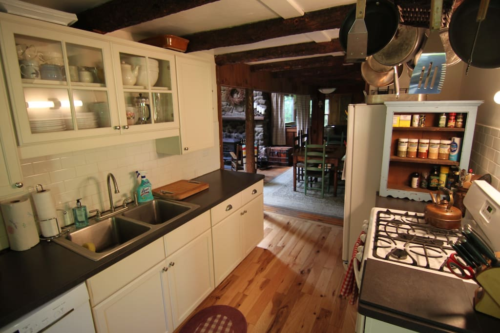 Clean updated kitchen w/ gas stove, Dishwasher, microwave, coffeemaker, toaster over, spices, serving ware, cooking tools, etc