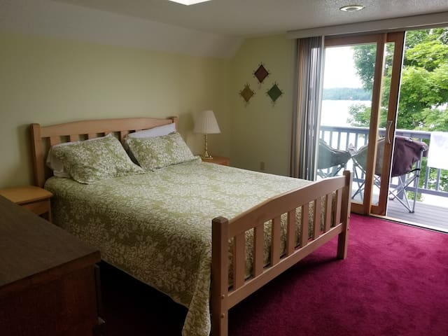 Bedroom 2 - Queen bed with slider out to small deck over looking the lake.