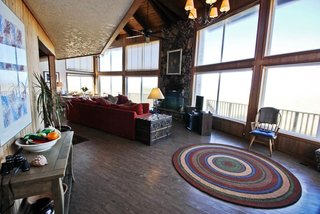 Lower level large entry into living room with flat screen cable TV/DVD, wood burning fireplace, large sectional, vaulted ceilings and large picture windows providing spectacular views!!