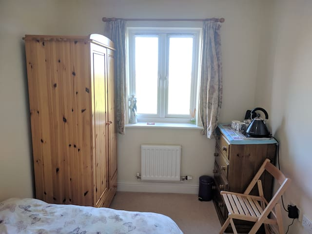 Comfortable and tidy room, overlooking the garden