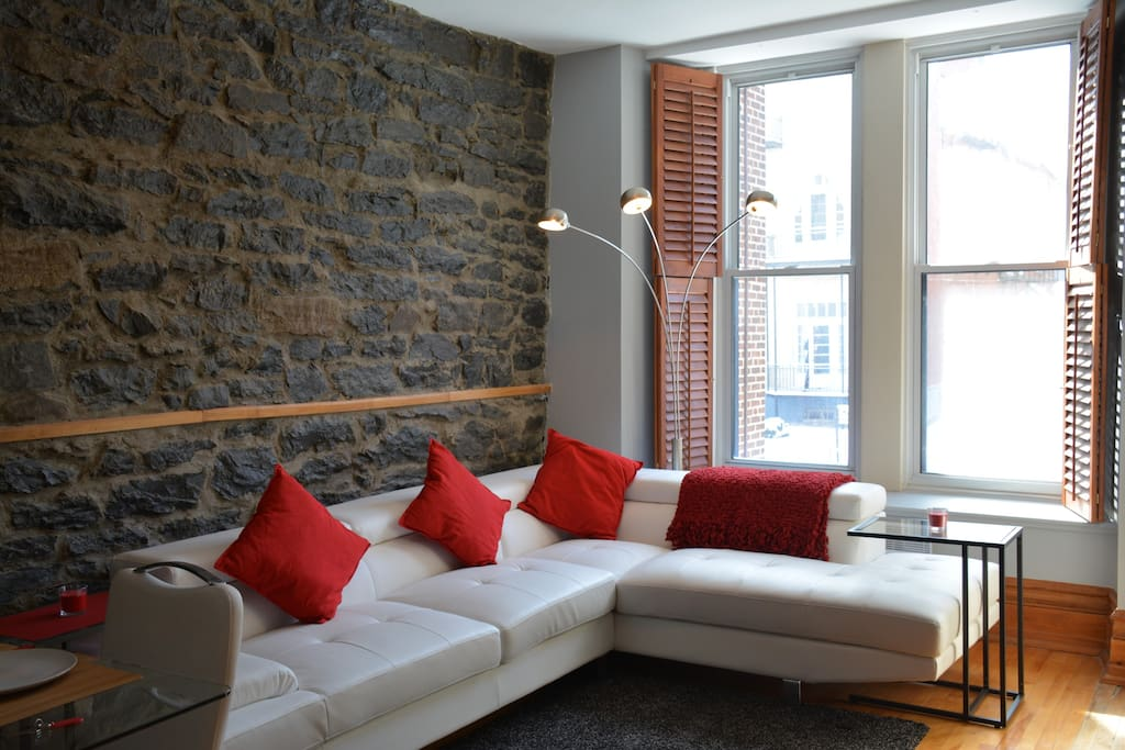 Fully renovated living room with view onto the street