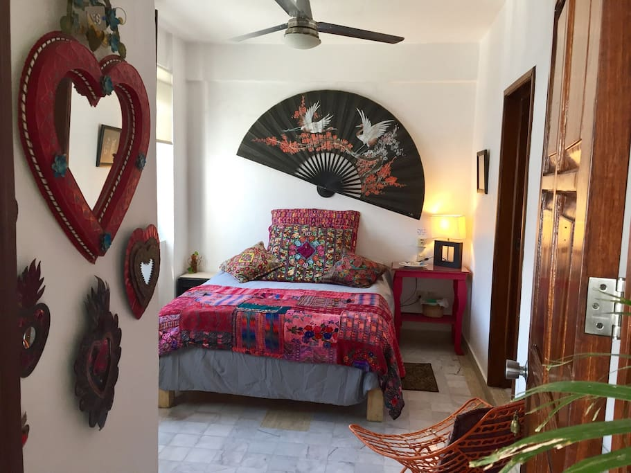 Cozy queen bed with big guatemala pillows. Private room and private bathroom.