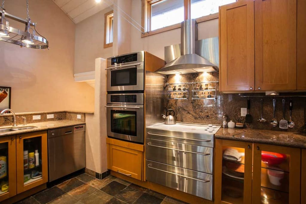 Beautiful updated kitchen with slab granite counter tops and stainless steel appliances.
