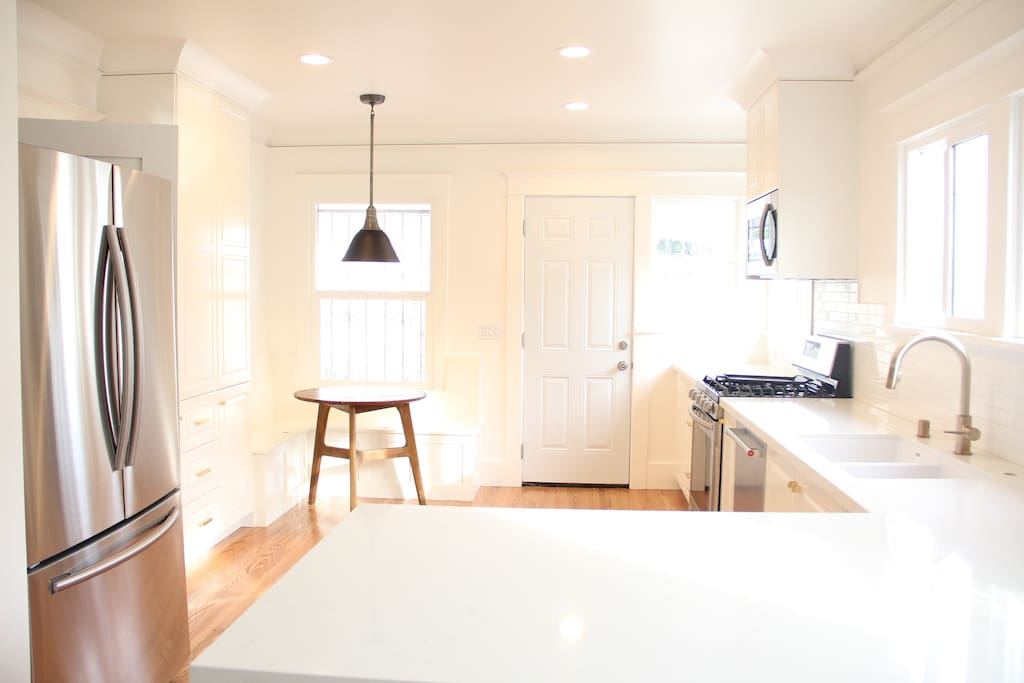 Light filled, open concept kitchen and dining room.