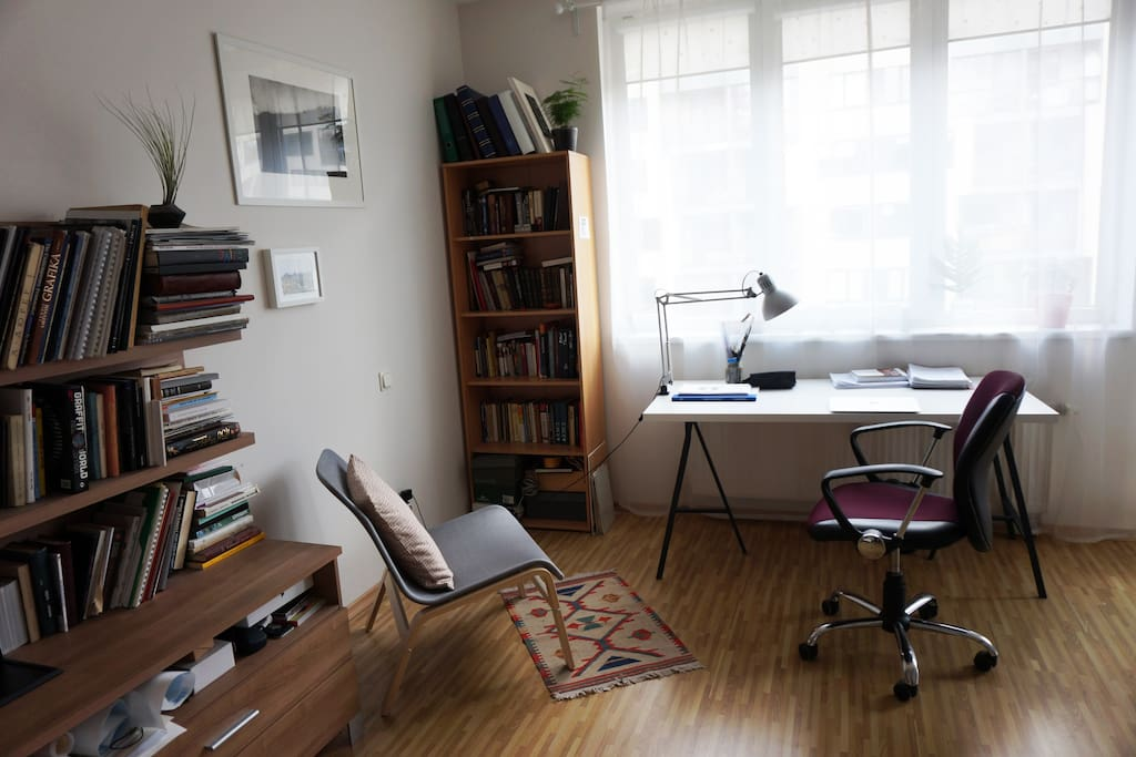 A nice place to work on your laptop while your friend is reading a book.