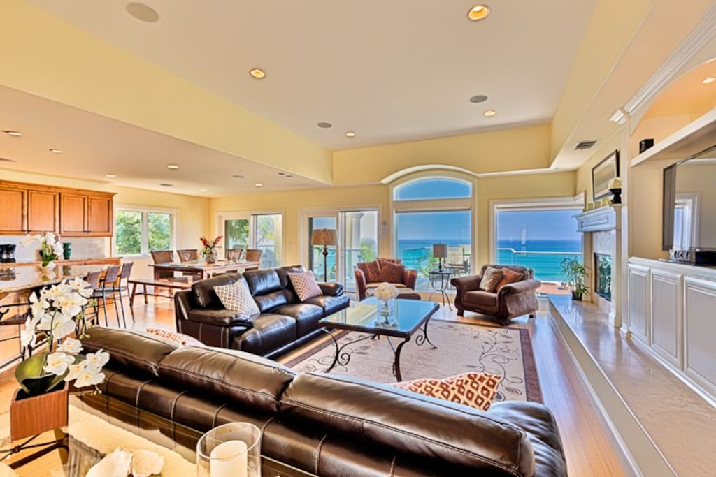 The living room upstairs with views that will stop you in your tracks!