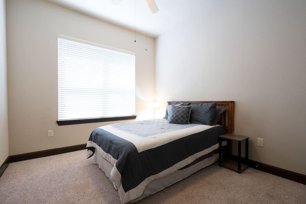 Full size bed in bedroom.