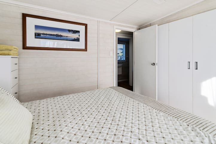 Lots of closet space in the one Queen-size bedroom (note all photos of the queen bed are the same bedroom, just with different linen). The closets contain  extra heaters, fans, blankets, linen, a dehumidifier and a baby bed for your use