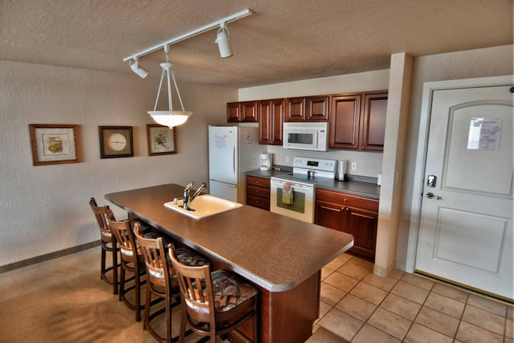 T303 Beautiful condo on Tagalong Golf Course overlooking Red Cedar lake