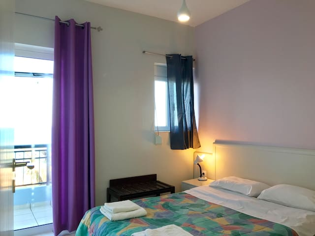 The seafront bedroom with a doubled and a balcony door.