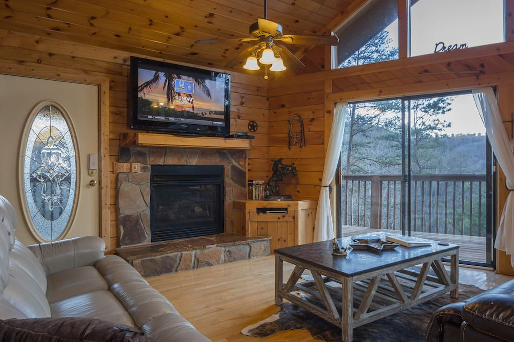 """Upstairs Has The Views! There Is 2 Leather Reclining Sofa's, A 50"""" Flatscreen TV, And A Gas Burning Fireplace (In Season).  All TV's In The Cabin Have Direct TV, With The NFL Sunday Ticket Channel."""