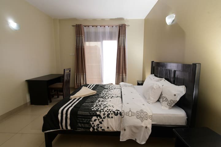 Master bedroom with king size bed & an 8 inch spring mattress.