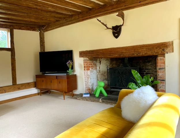 Vintage furniture complements the ancient beams