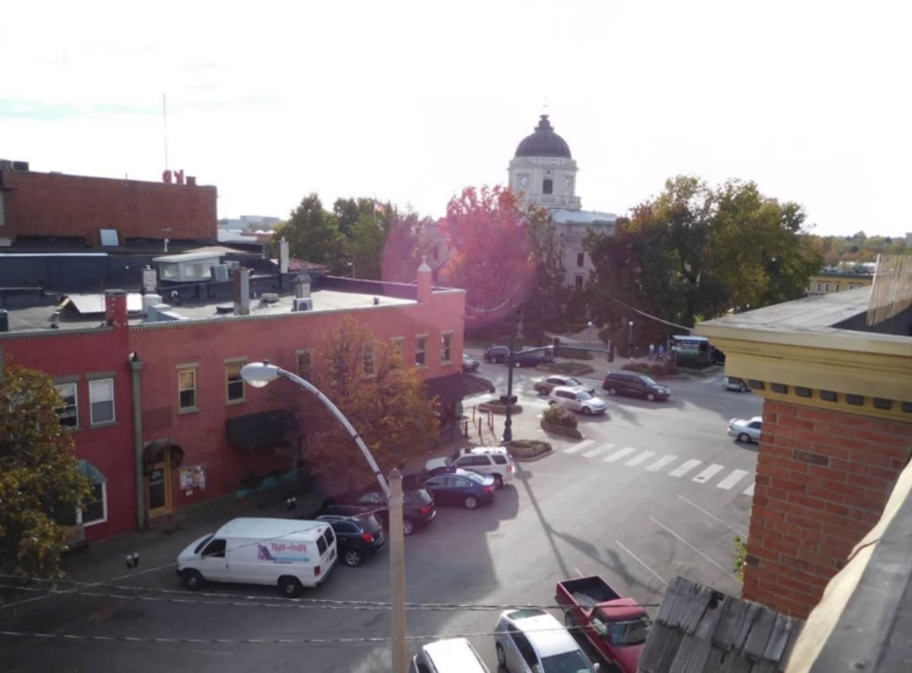 View of the courthouse square from rooftop deck - campus is also visible in the other direction.