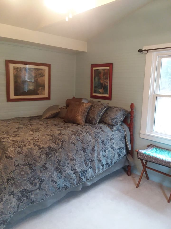 Large  cozy bedroom with double bed.