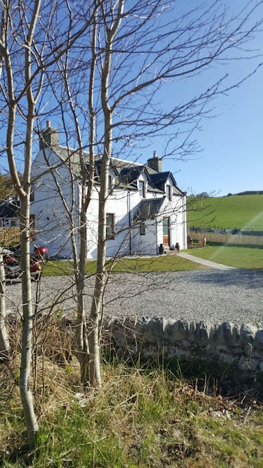 The front of Jacobite Lodge from the bridge over the burn