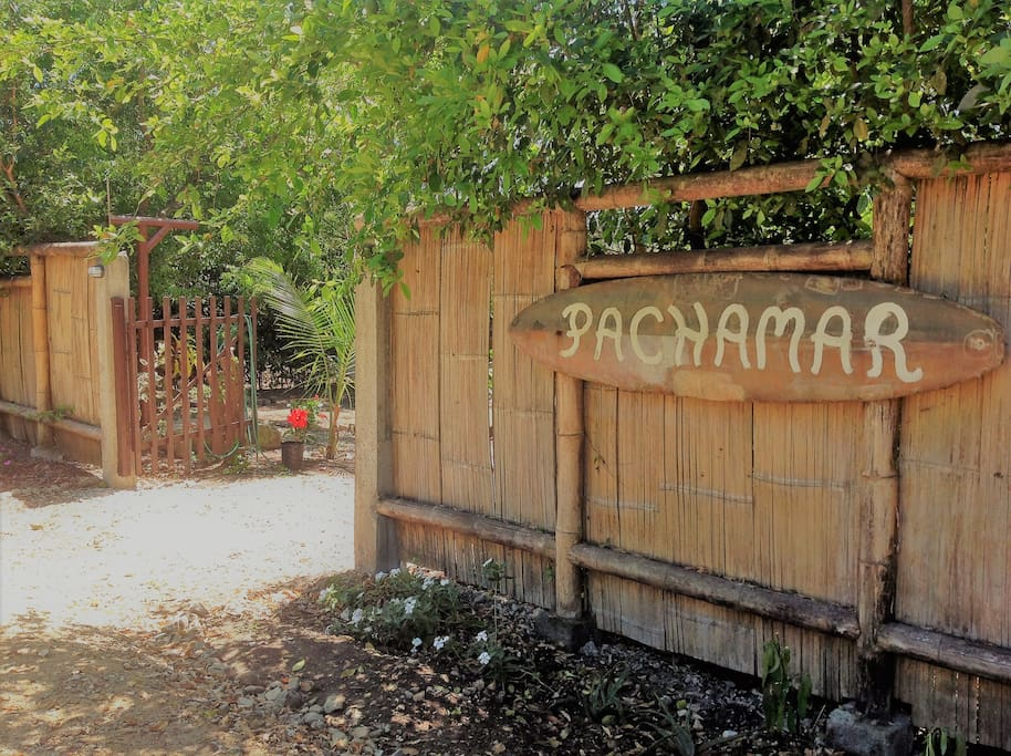 Fence and PACHAMAR sign to announce paradise!
