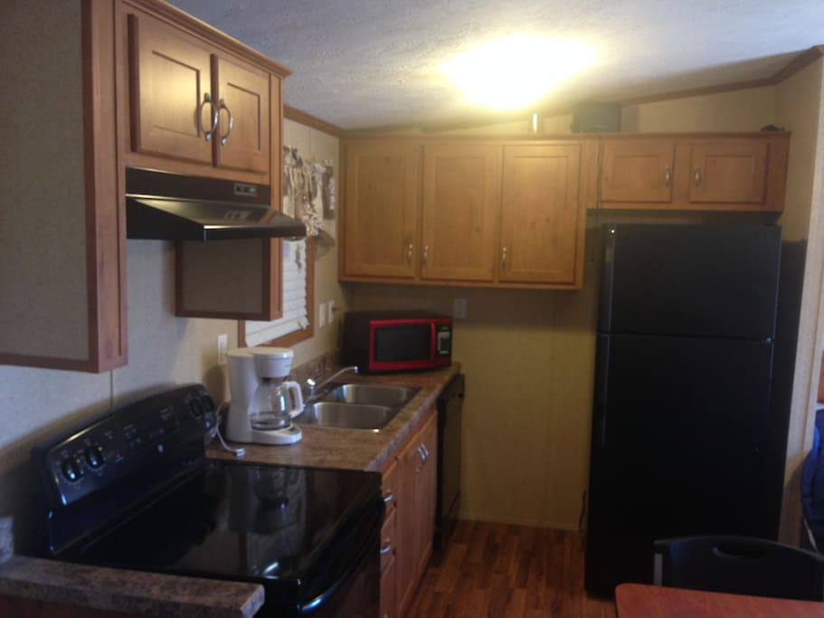 Full Kitchen with Sink, Dishwasher, Range, Refrigerator, Microwave, and Coffee Maker!