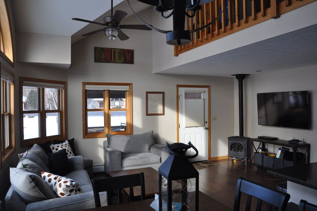 "The living room has a gas fireplace (winter use only) and a large 60"" TV with cable/DVD/Netflix and is open to the second story loft."