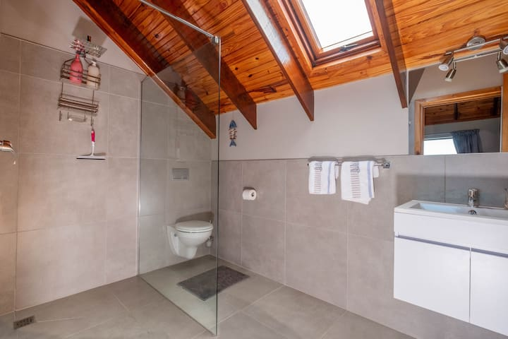 On suite bathroom with spacious walk in shower