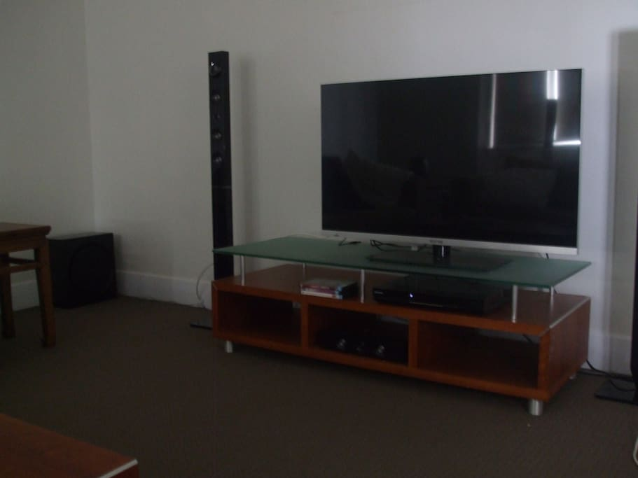 TV with surround sound in comfortable roomy lounge