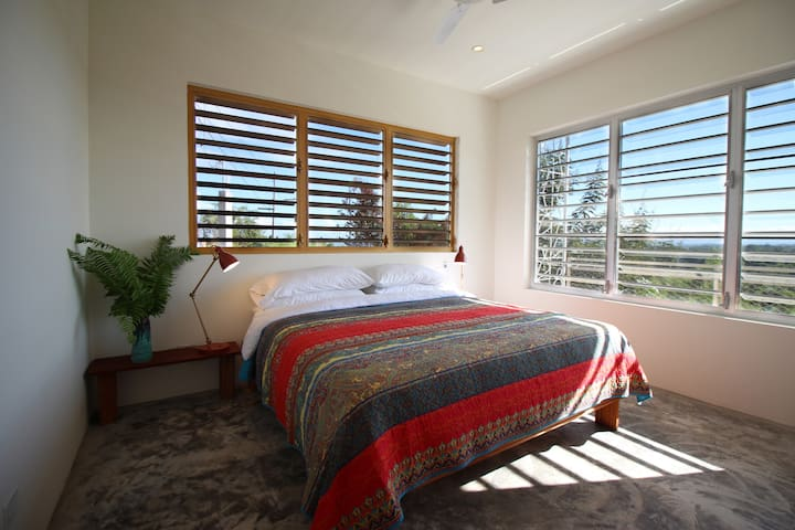 Bedroom #3 with king bed, ocean views and a private bathroom with tub.