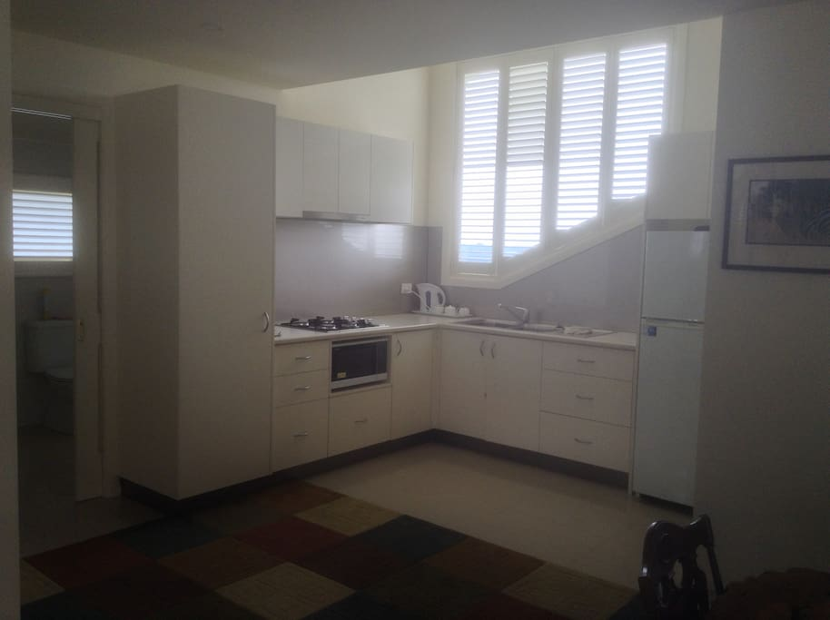 The kitchen is spacious and  well equipped with gas cook top and convection microwave oven.
