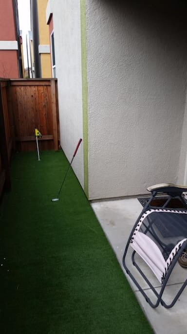 Putting green.  Putter and balls provided. Big breaking green!