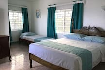Enjoy the privacy of this room, the only one located on the second floor.  Featuring a PRIVATE BALCONY that over-looks the beach and the sea!