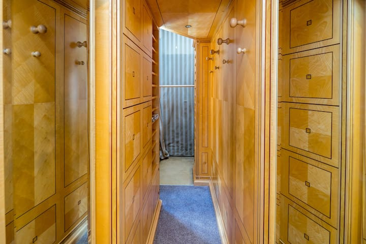 There is a walk-in closet that would suit well for long-stays