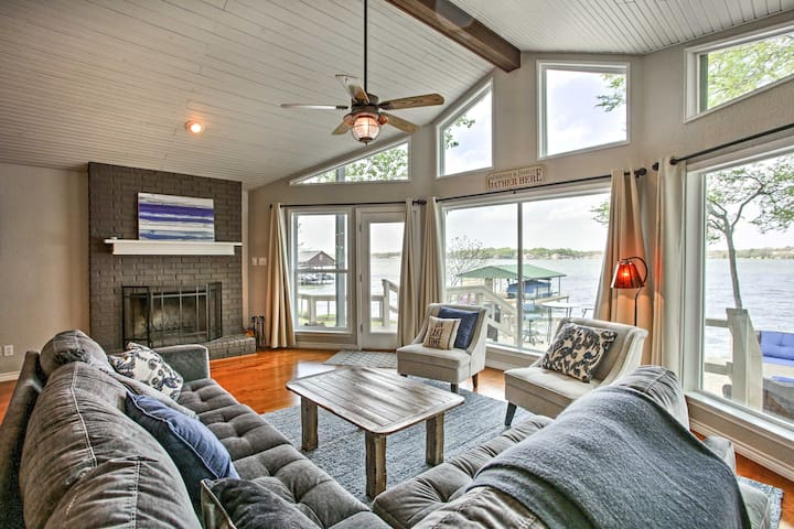With floor-to-ceiling windows and lake views, the living room is very cozy.