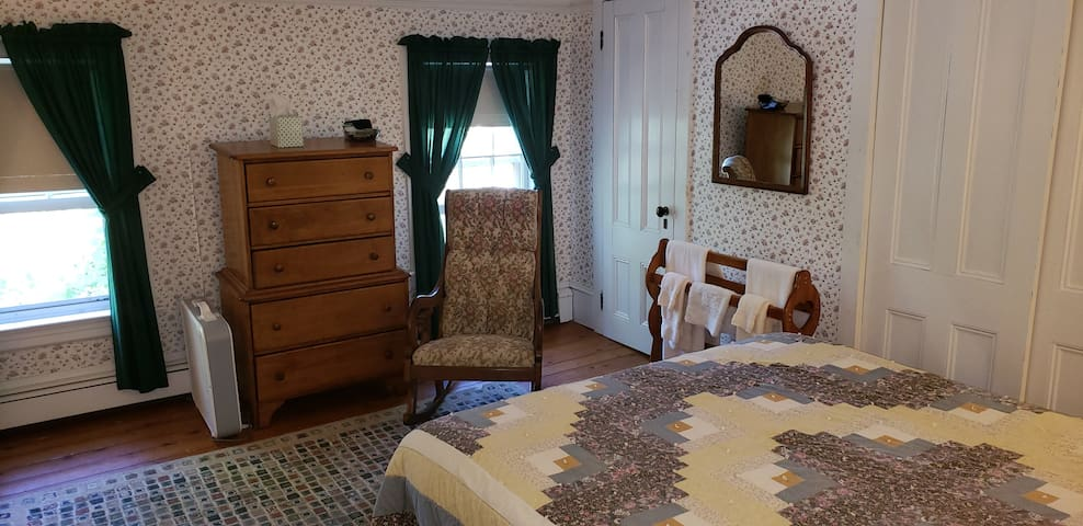 Large room w/queen bed, twin bed, shared bath.